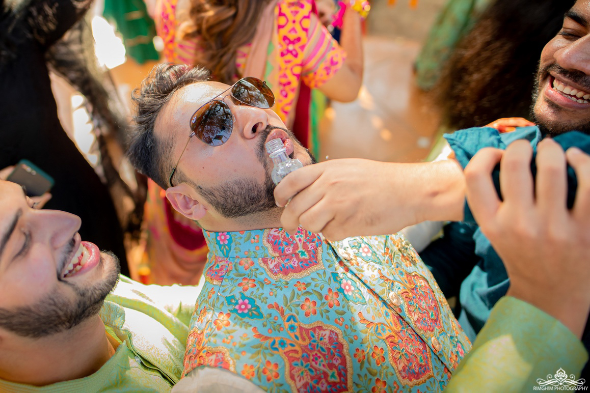 Indian Groom Drinking at Sangeet Images