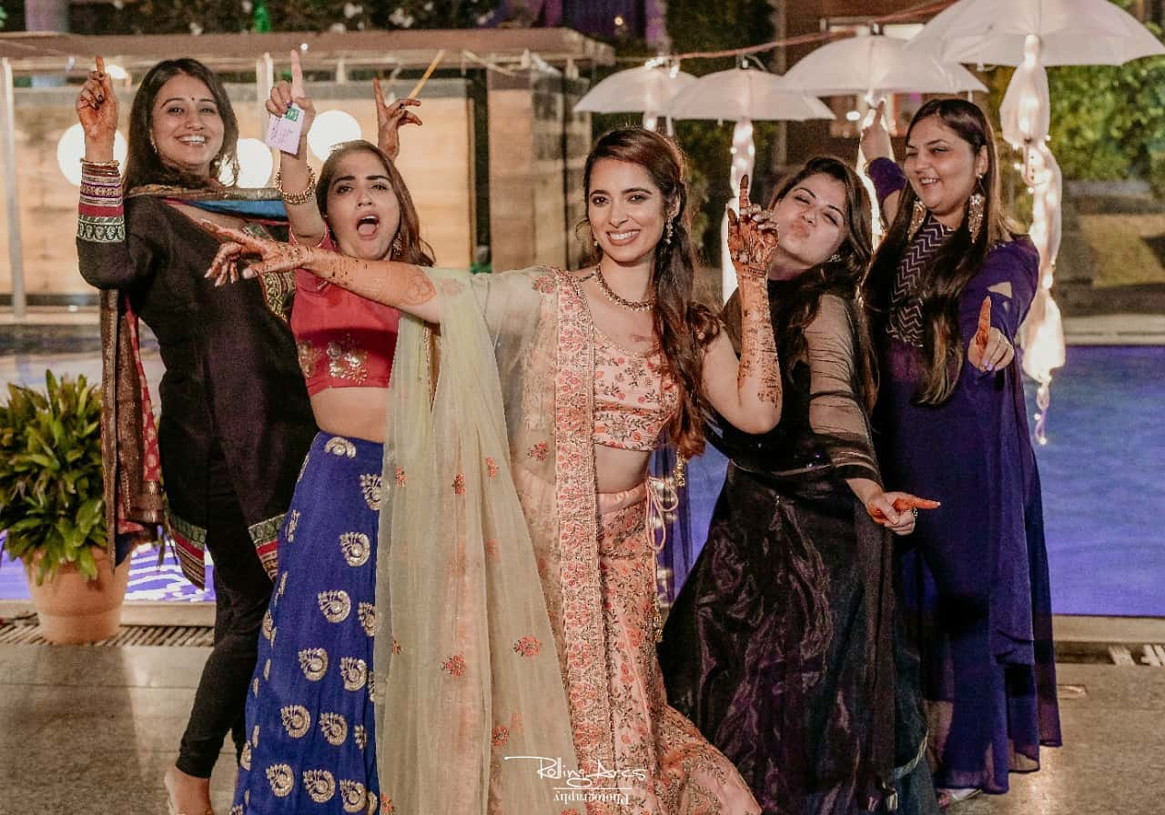 Bride posing with her Bridesmaids at Mehndi Ceremony