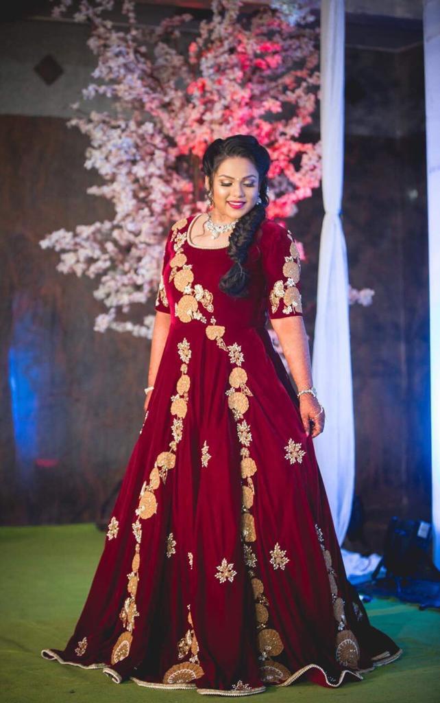 bride in stunning maroon gown