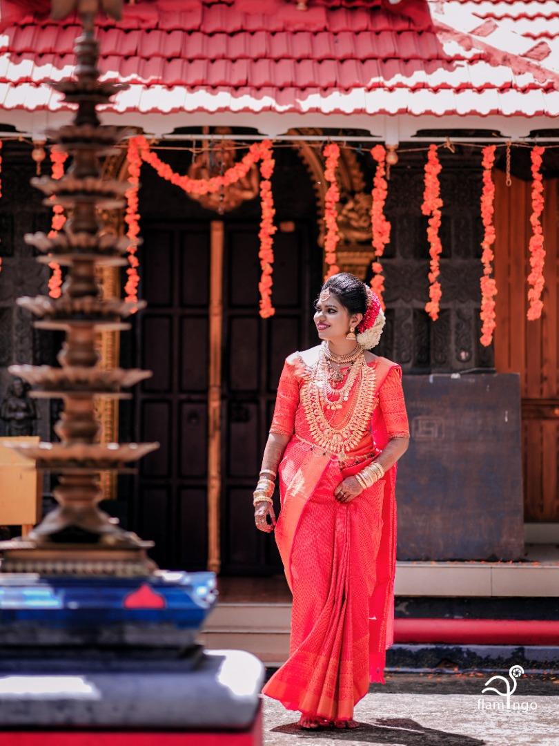 bride in red silk saree