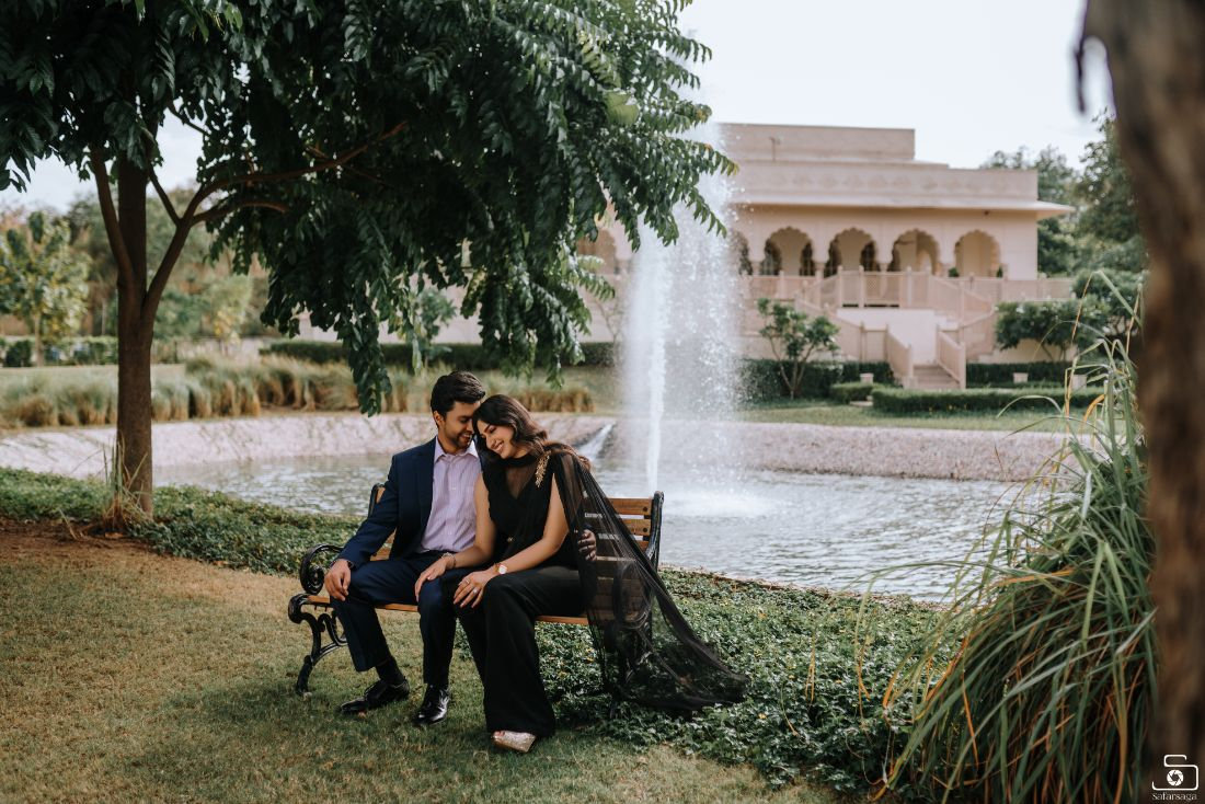couple pose near a fountain