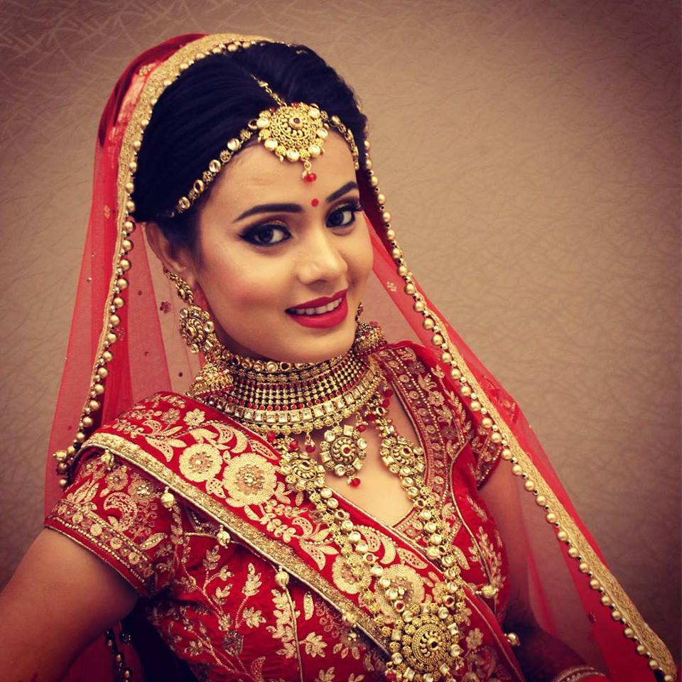 Golden Jhumka with Red Lehenga
