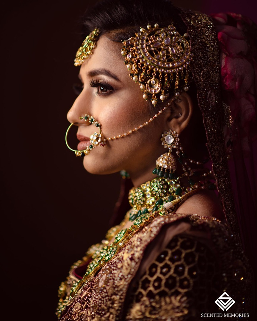 Bridal side portrait with gorgeous jewelry and maang tikka