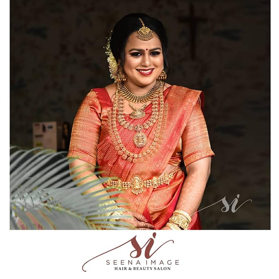 bride in silk saree and heavy jewelry