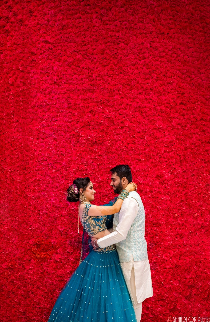 Beautiful Wedding Picture with Rose Backdrop