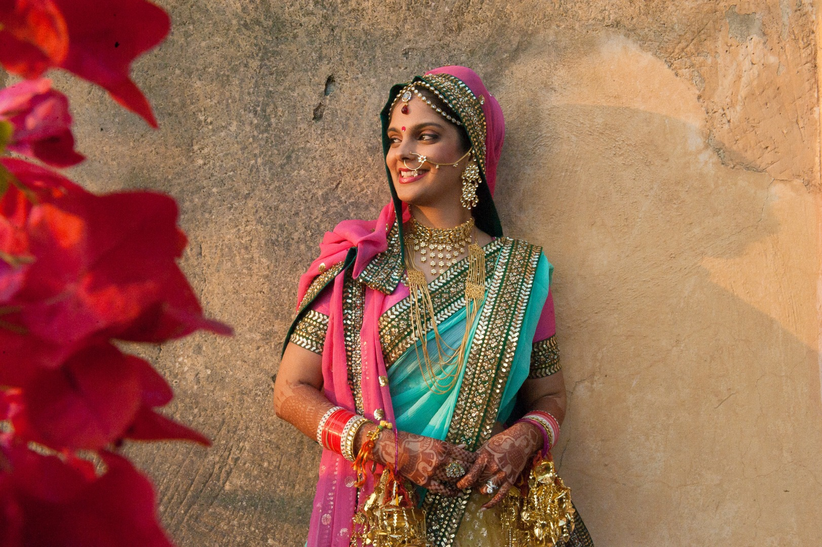 stunning bride in pink and blue lehenga
