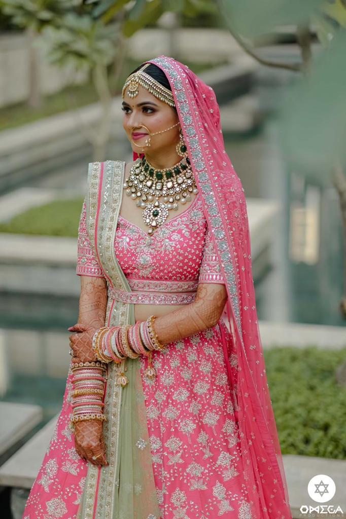 bride in pink lehenga with pink natural makeup