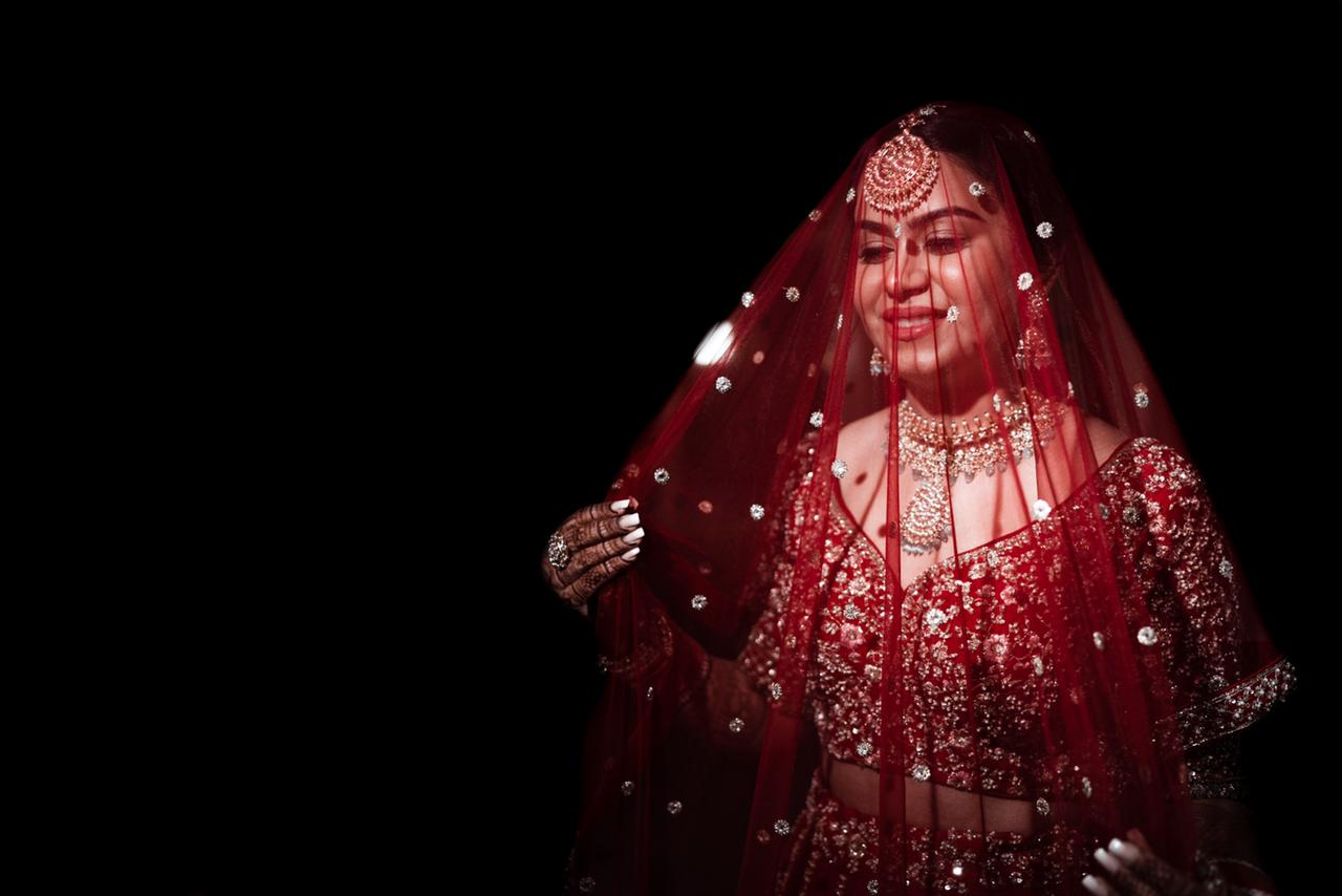 bride poses with her long dupatta
