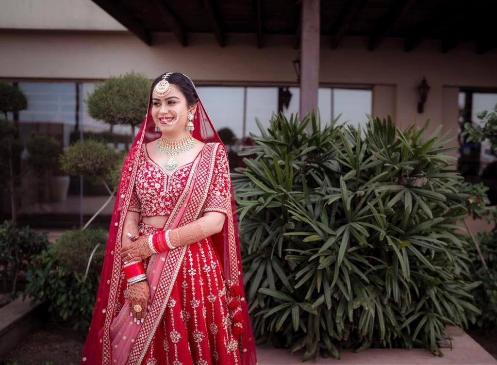 happy bride in red with natural bridal makeup