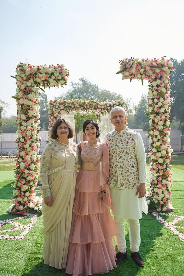 bride in a soft pink lehenga