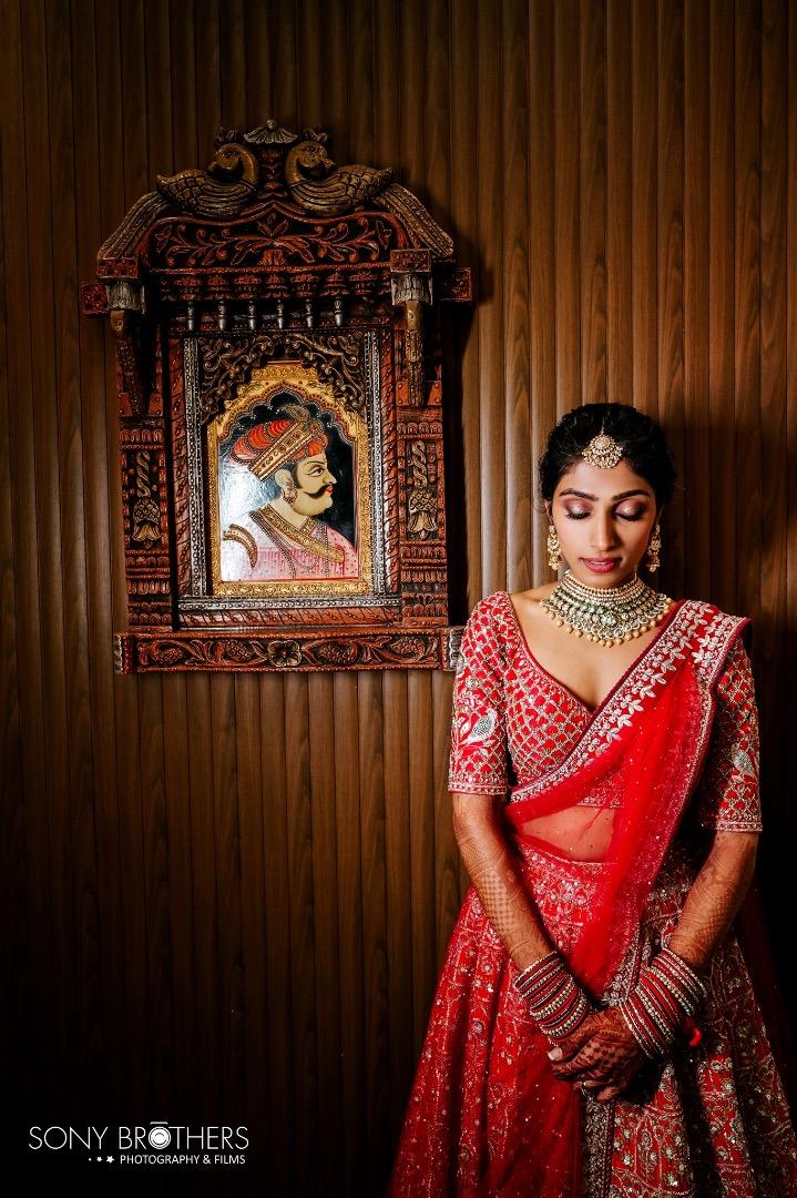 bride in red bridal lehenga