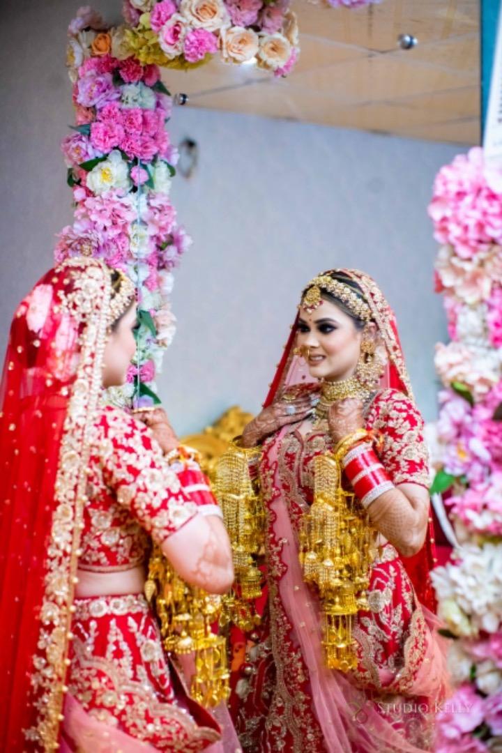 bride in red and golden kaleere