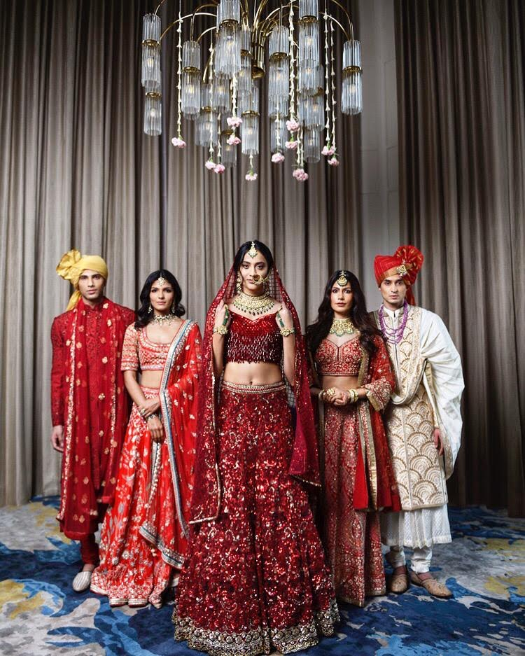 bride poses with her friends