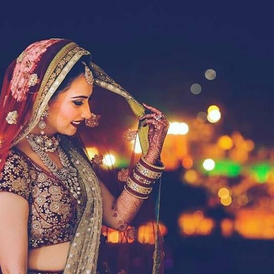 Beautiful bride in maroon lehenga in natural glowing makeup