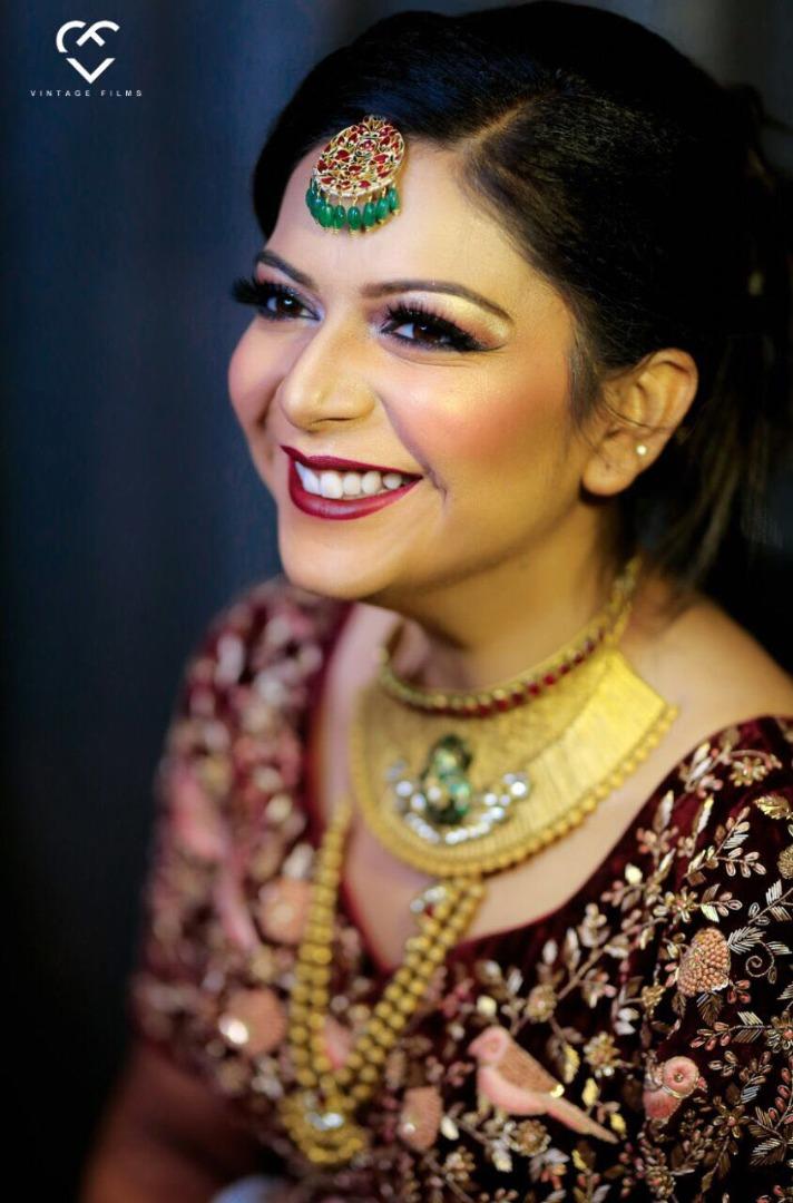 Gorgeous bride smiling in solo bridal portrait