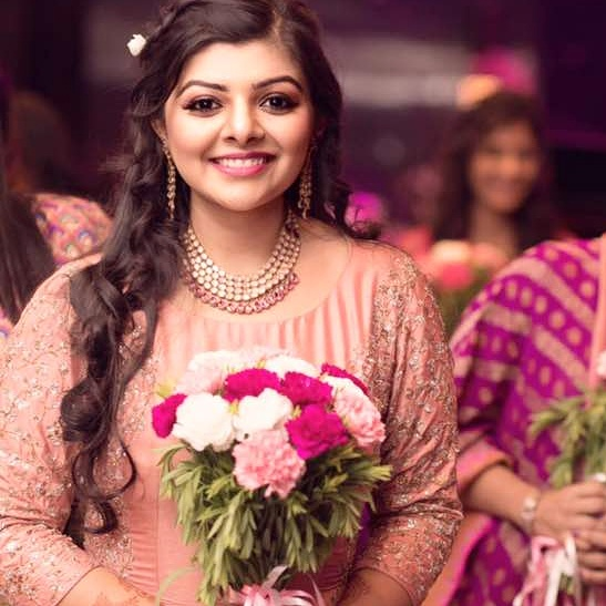 Beautiful natural pink glowing makeup of Indian bride for engagement ceremony
