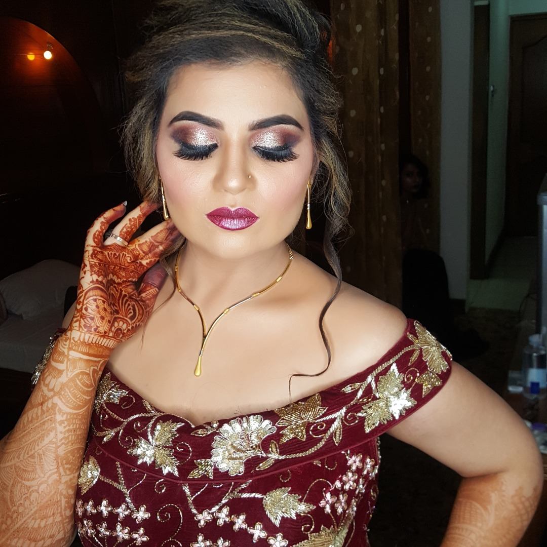 Beautiful reception makeup of bride in red attire