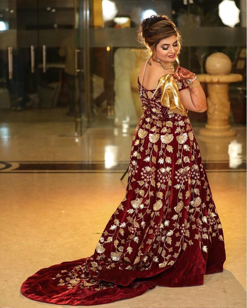 Beautiful bride in red designer lehenga with floral bun