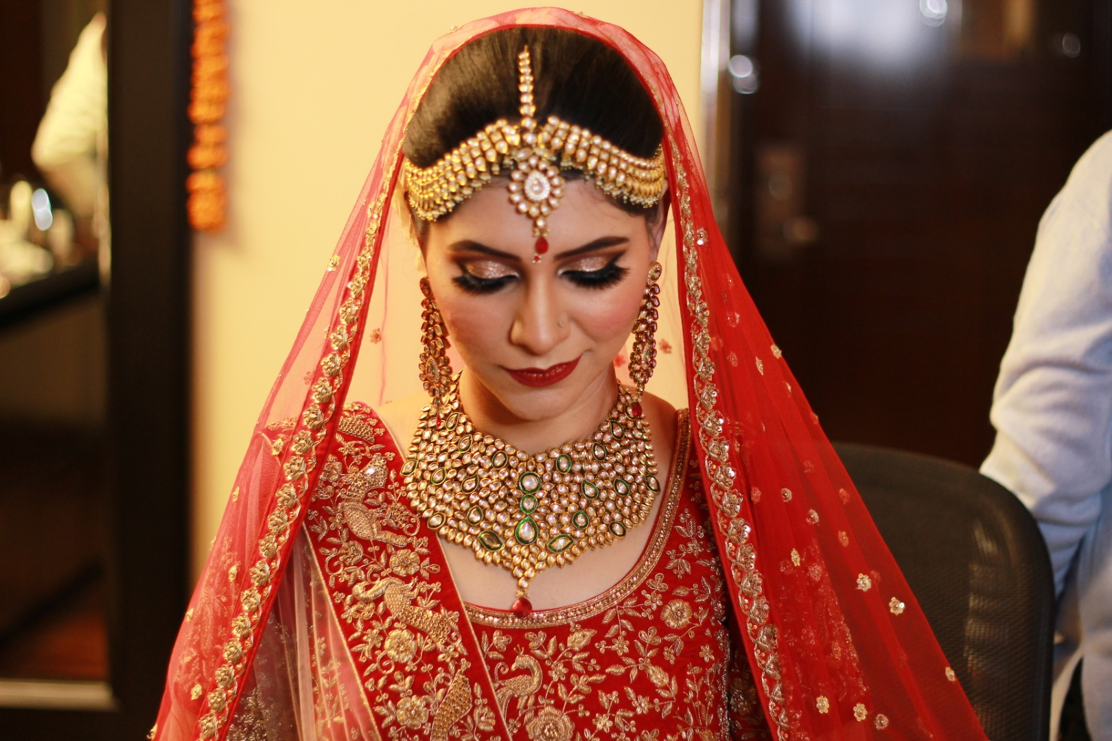 Beautiful bride in orange lehenga and golden jewelry