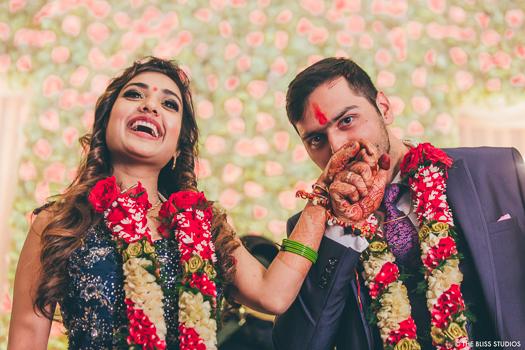 groom kissing bride's hands