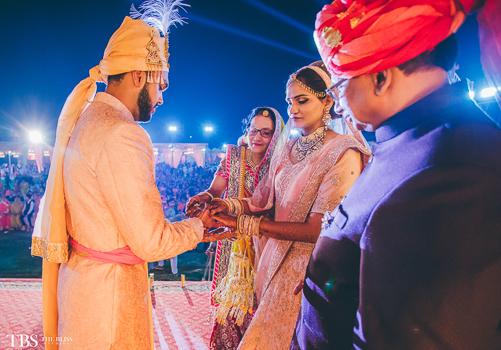 couple shot during their wedding rituals