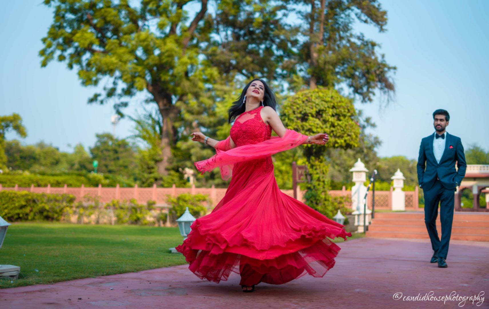 bride twirl in her red lehenga