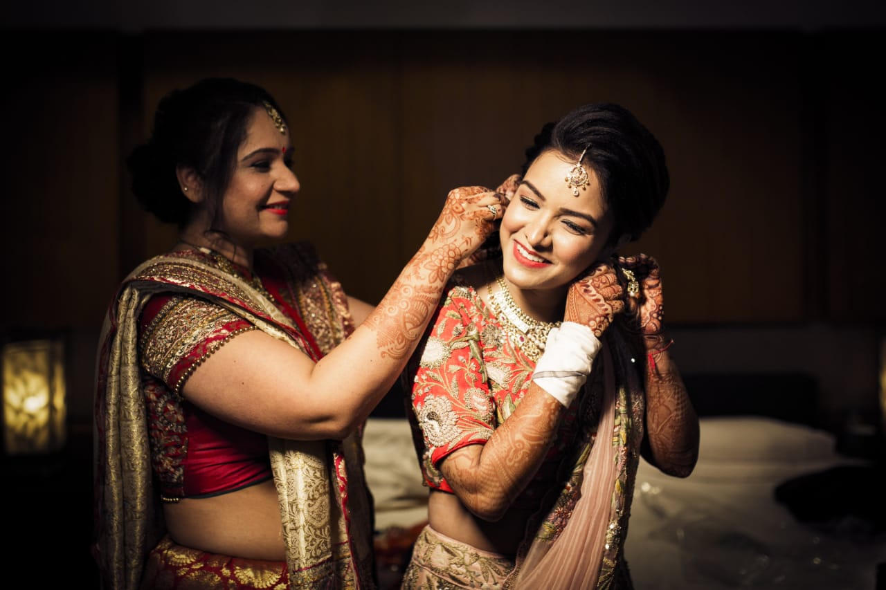 bride poses with her mother