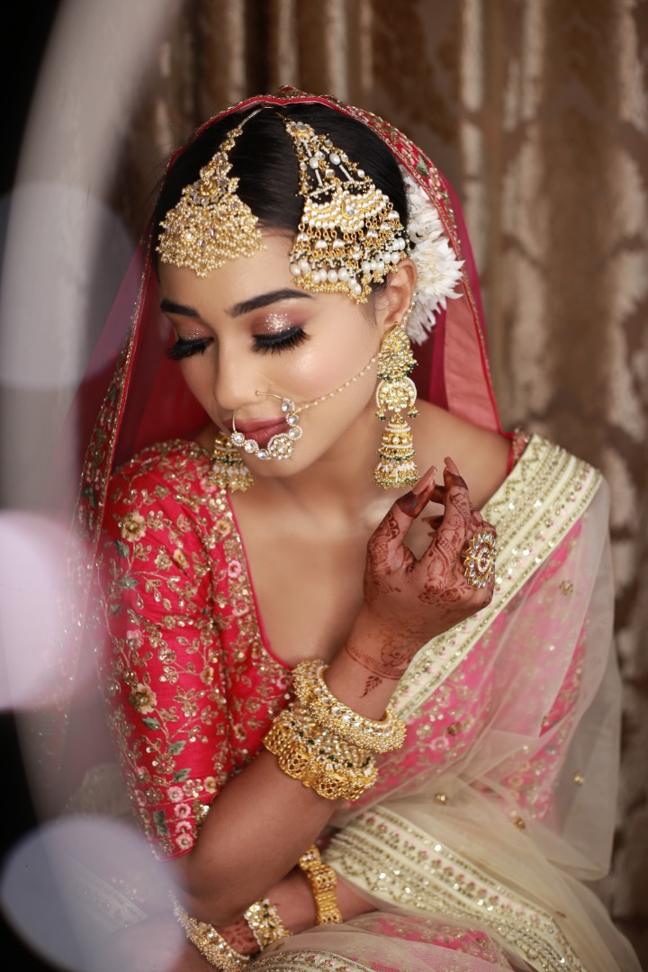 bride in shimmery eye makeup with pink lips