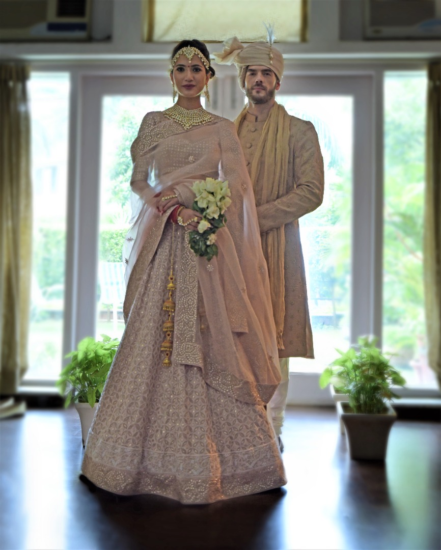 couple in coordinated blush pink outfits
