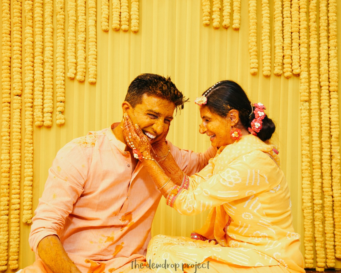 Couple having fun at Haldi Ceremony