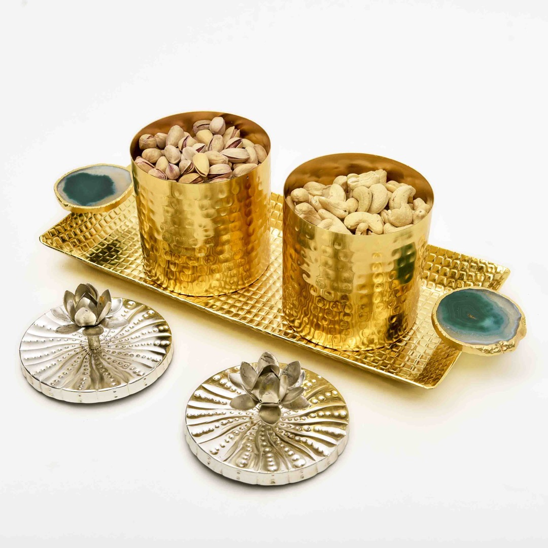 copper bowls and trays with dry fruits