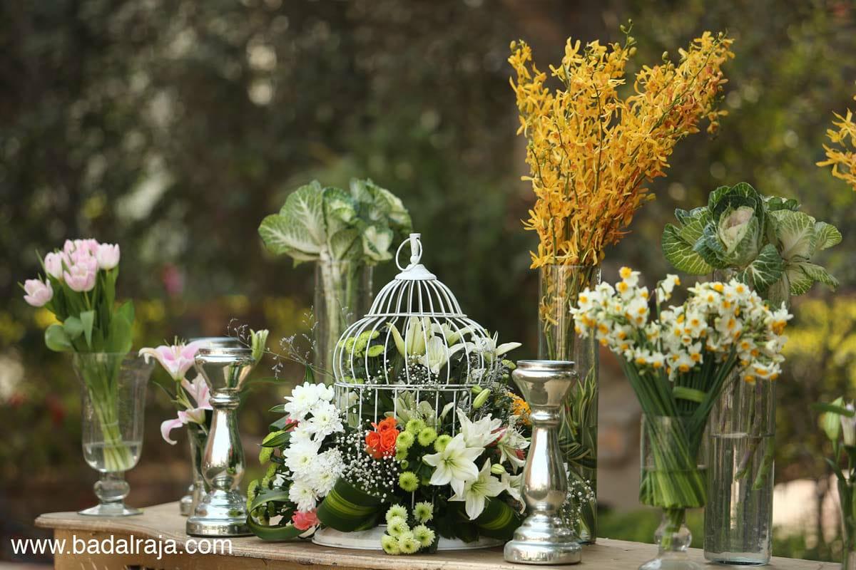 unique floral centerpieces and birdcage as decor