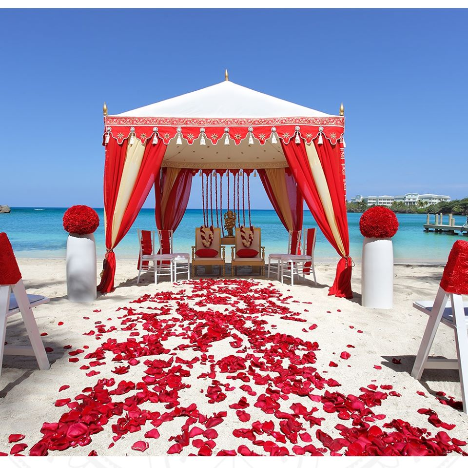 beach wedding in red and white