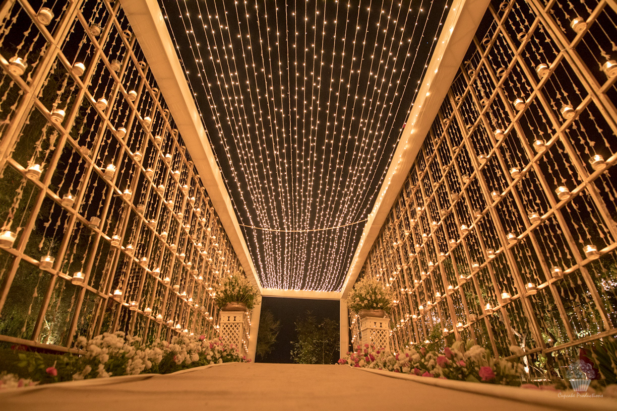 Rajnigandha Flower Strings, Tea Lights and Fairy Lights Stunning Wedding Entrance Decor