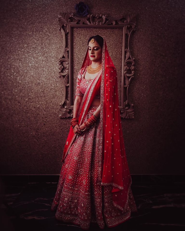Red Bridal Lehenga with Golden Jewelry