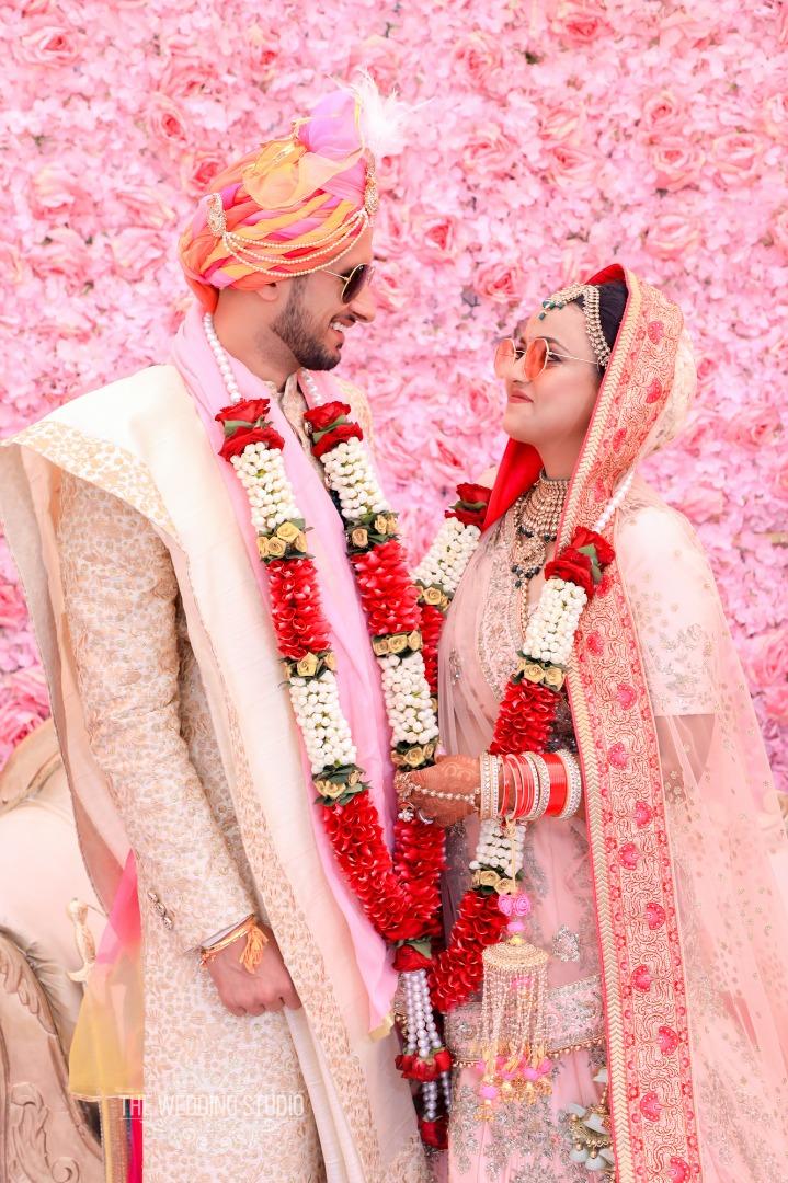 Cool Indian Wedding Couple wearing Sunglasses