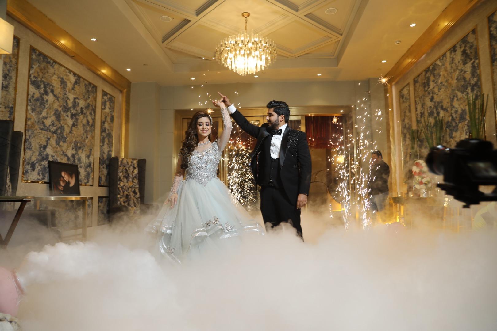 bride twirls with her groom