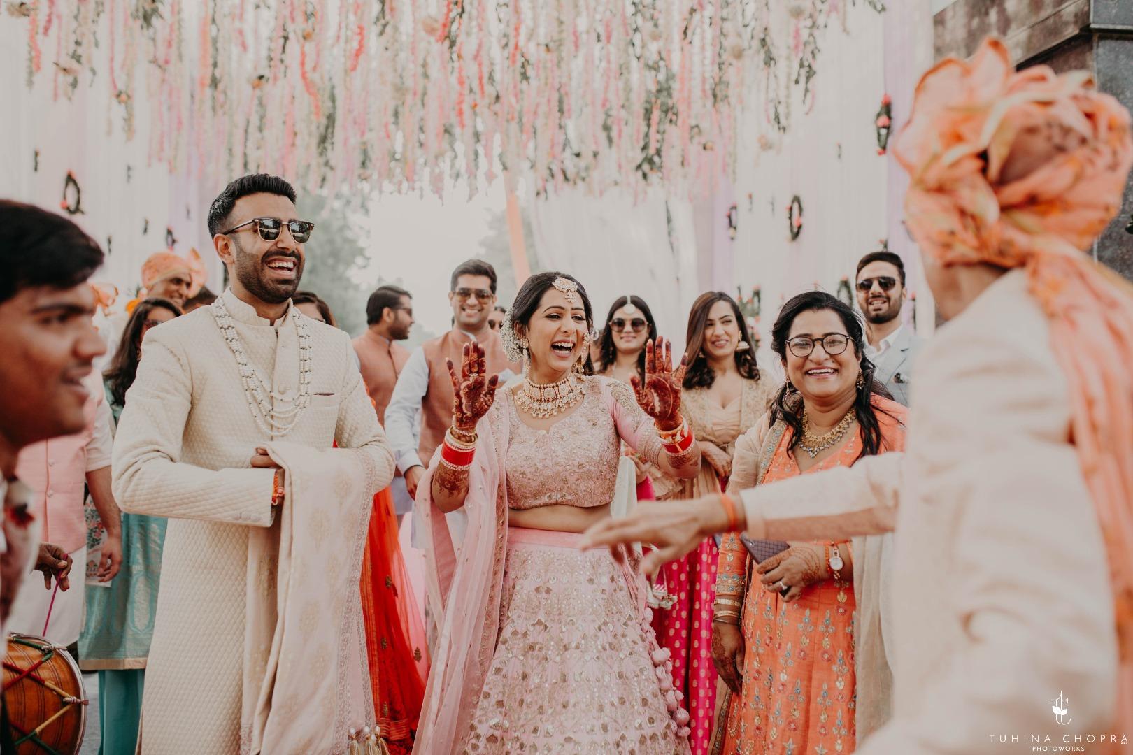 Candid capture of bride and groom dancing