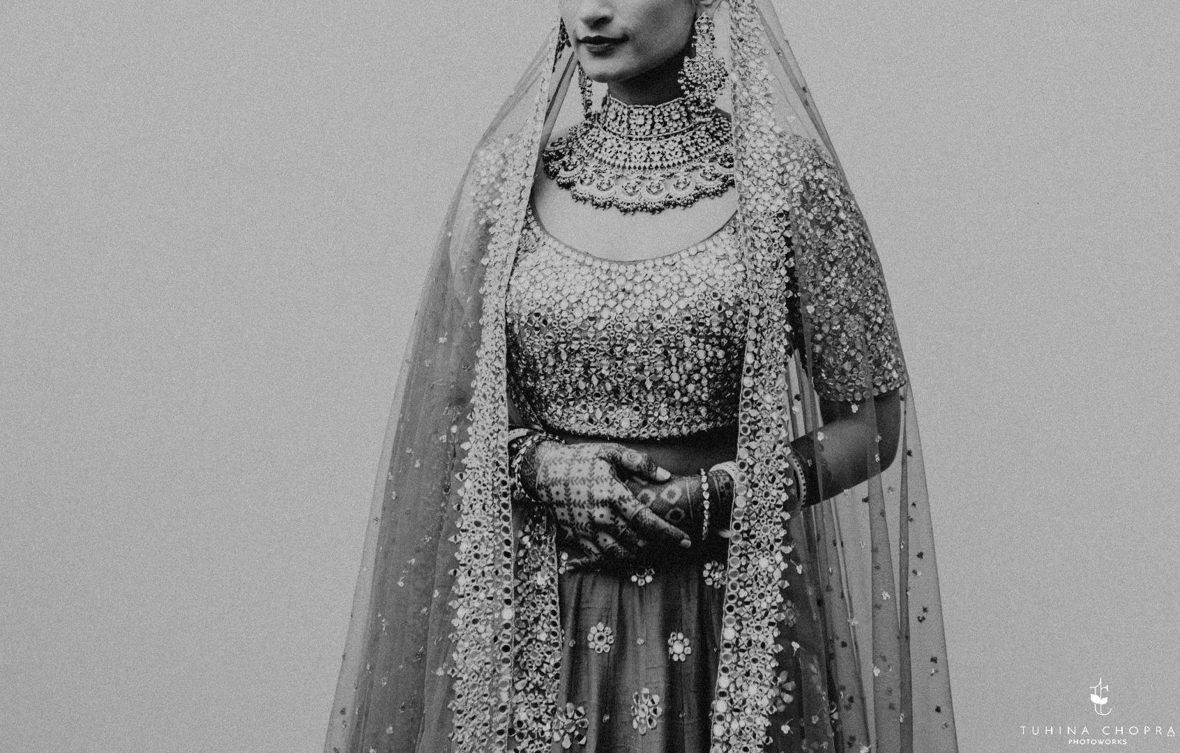 Black and white photo of bridal lehenga and jewelry