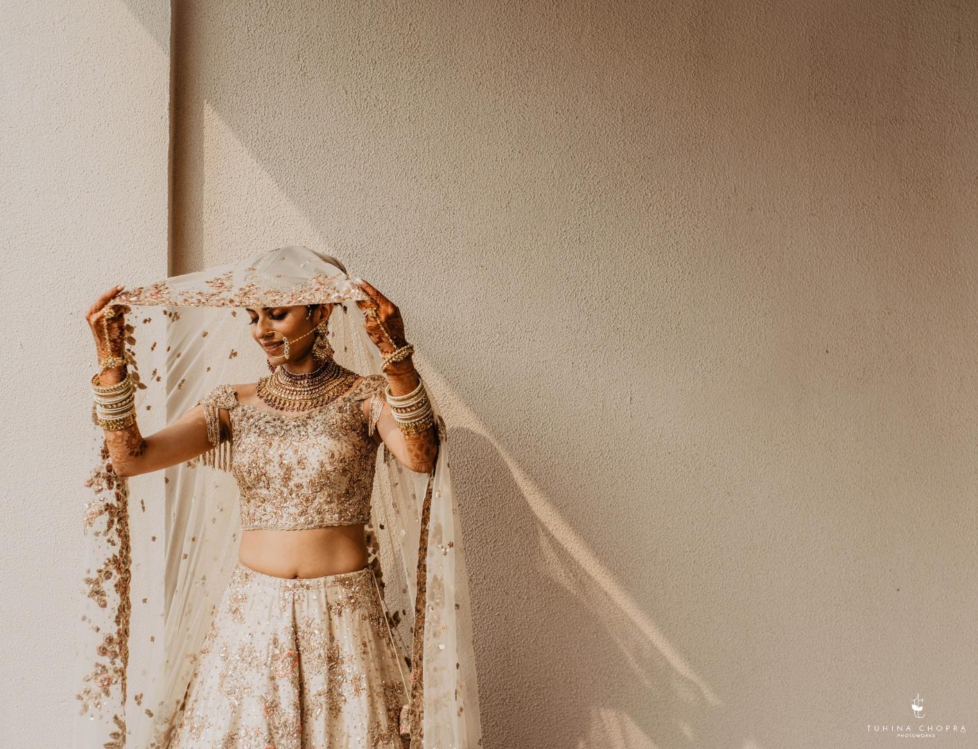 Beautiful bride under the sunlight in gorgeous lehenga