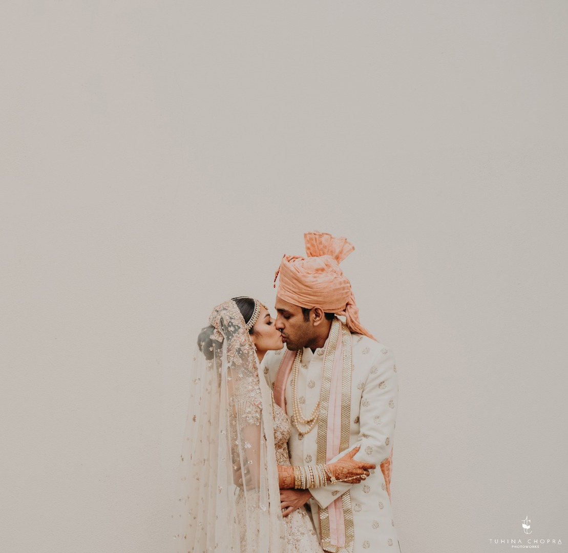 Bride and groom kissing aesthetically