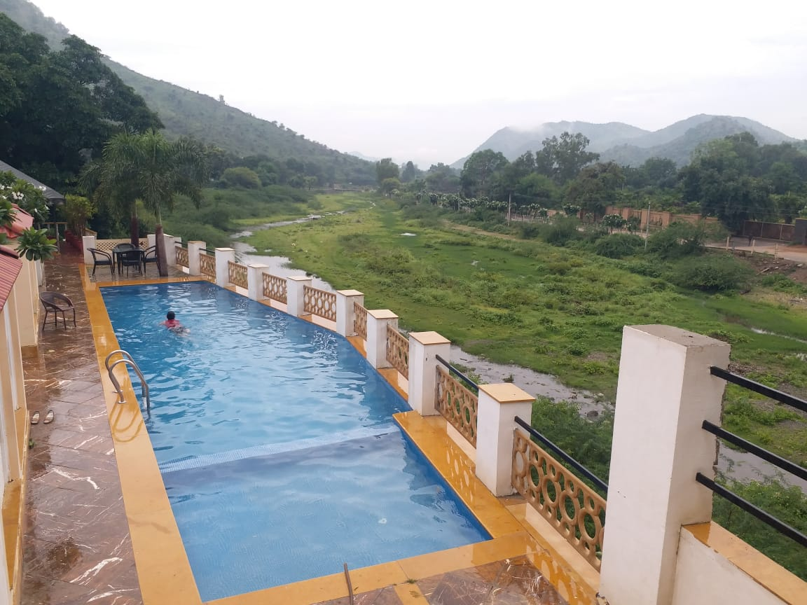 infinity pool with a hill view