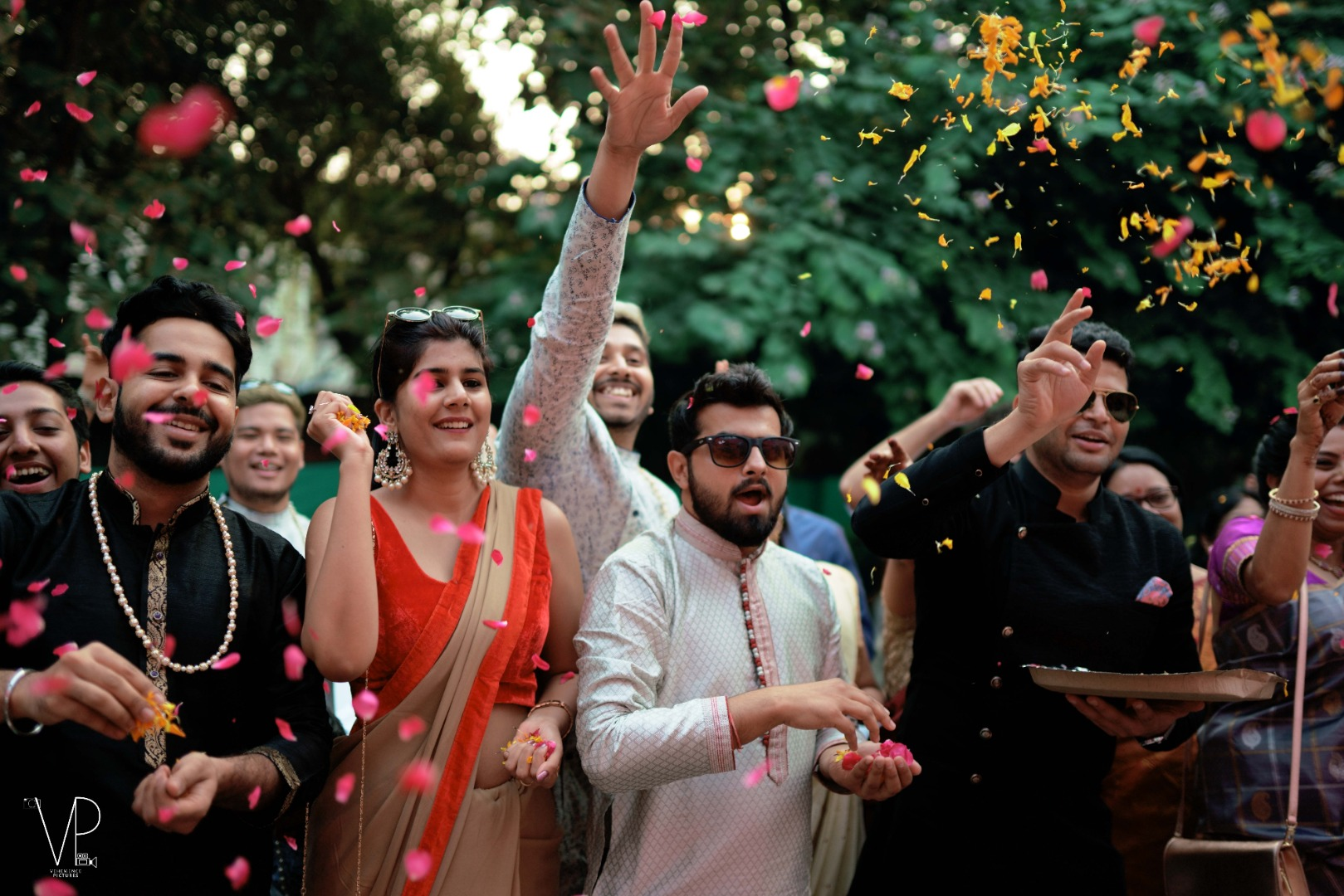 Friends Throwing Flower Petals on the Newly Weds