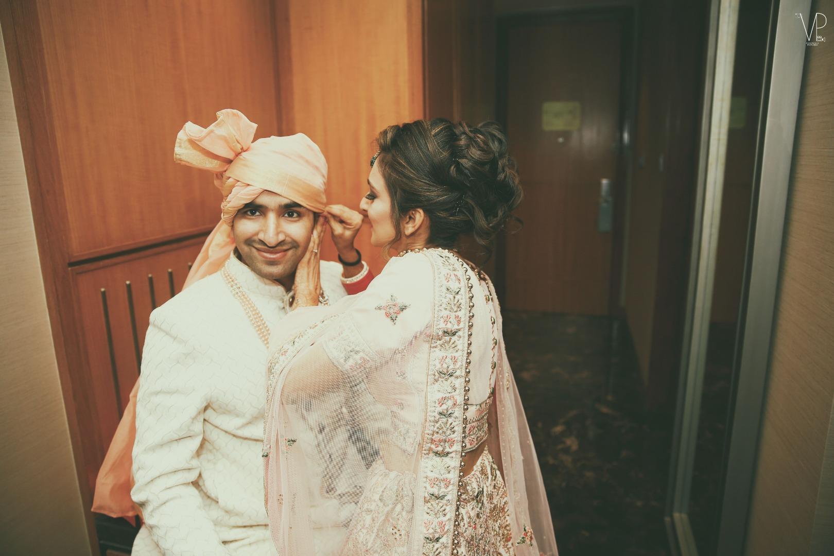 Indian Bride helping Groom Get Ready