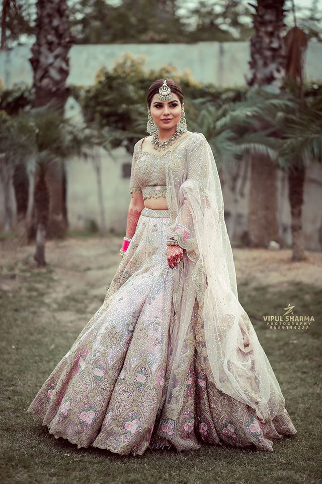 Indian Bride in White Ivory Wedding Lehenga