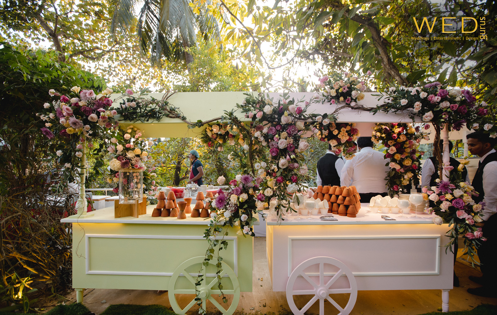 pastel colored food stalls decorated with flowers