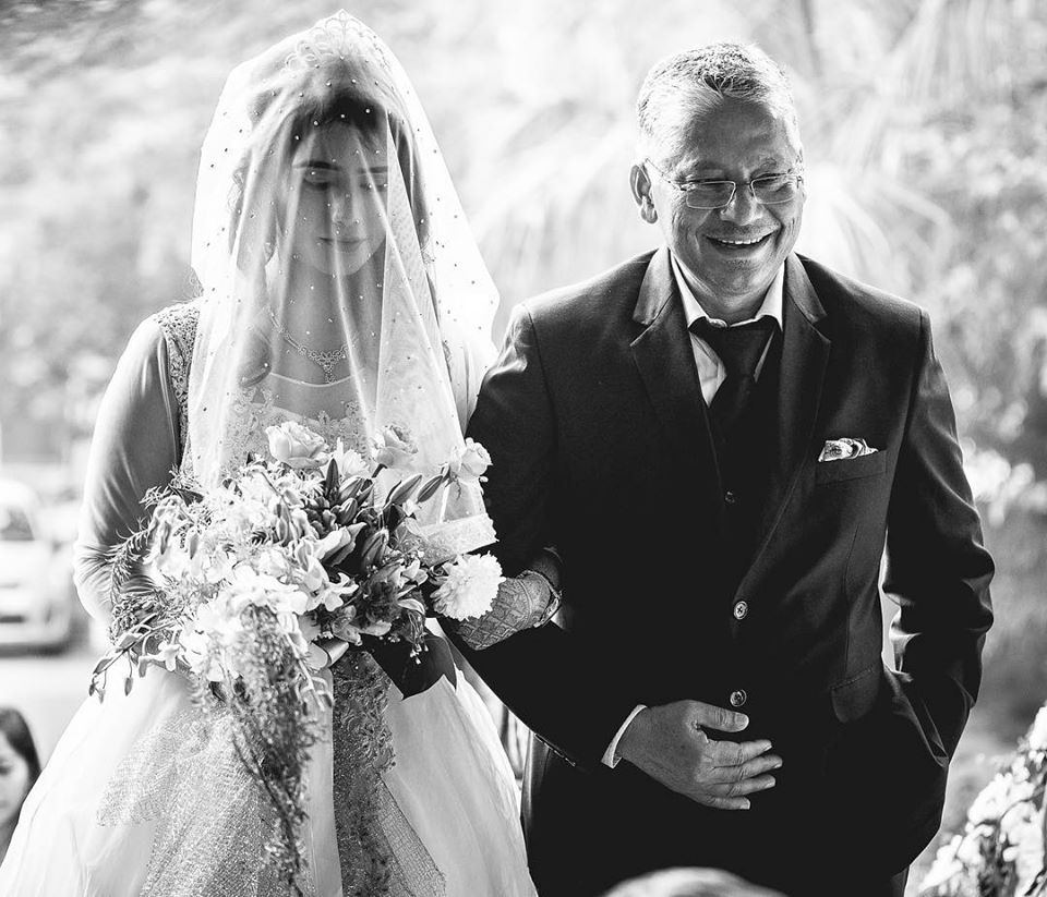 Black & White Picture of Christian Bride Walking Down The Aisle With Her Father