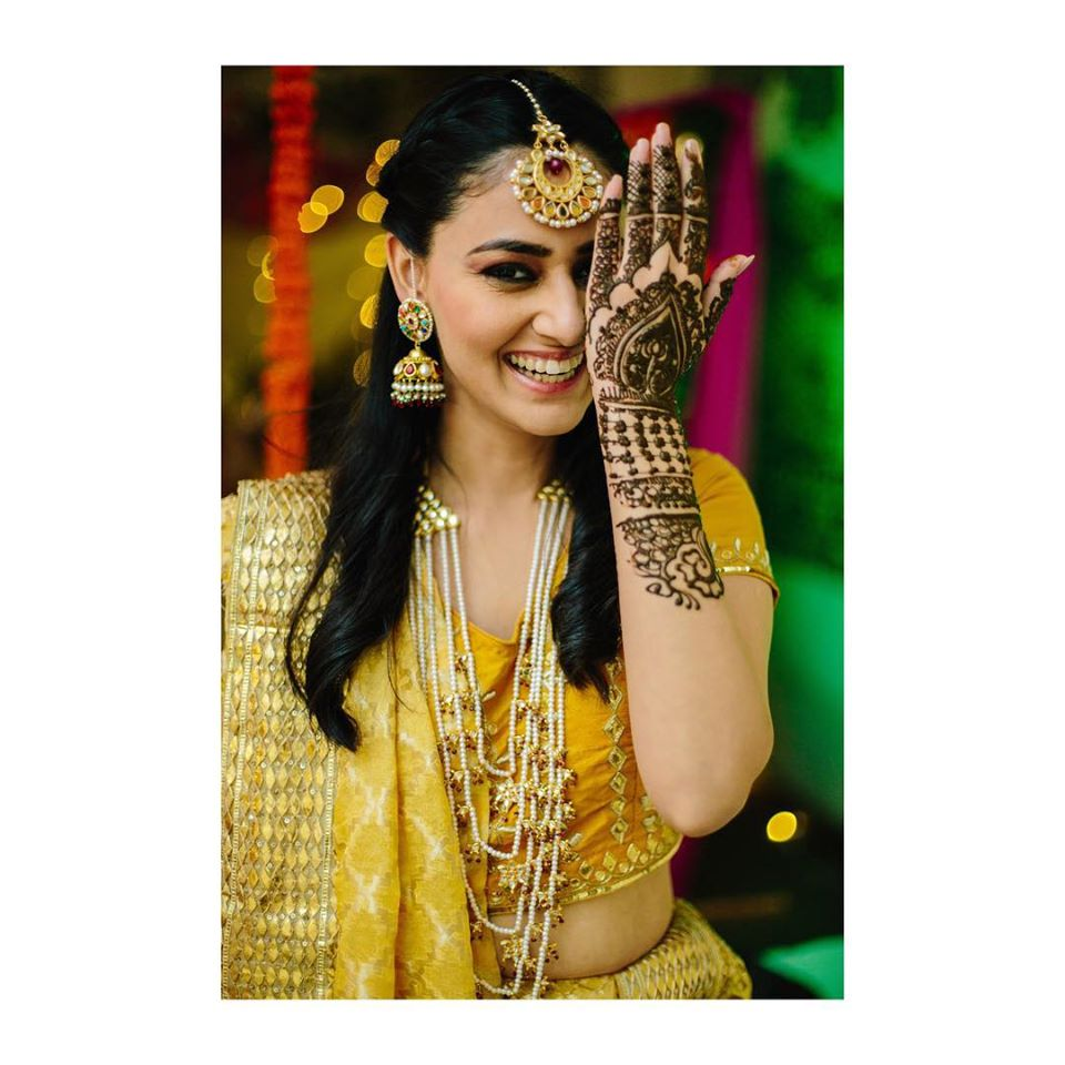 Cute Bride Mehendi Picture in Yellow Outfit