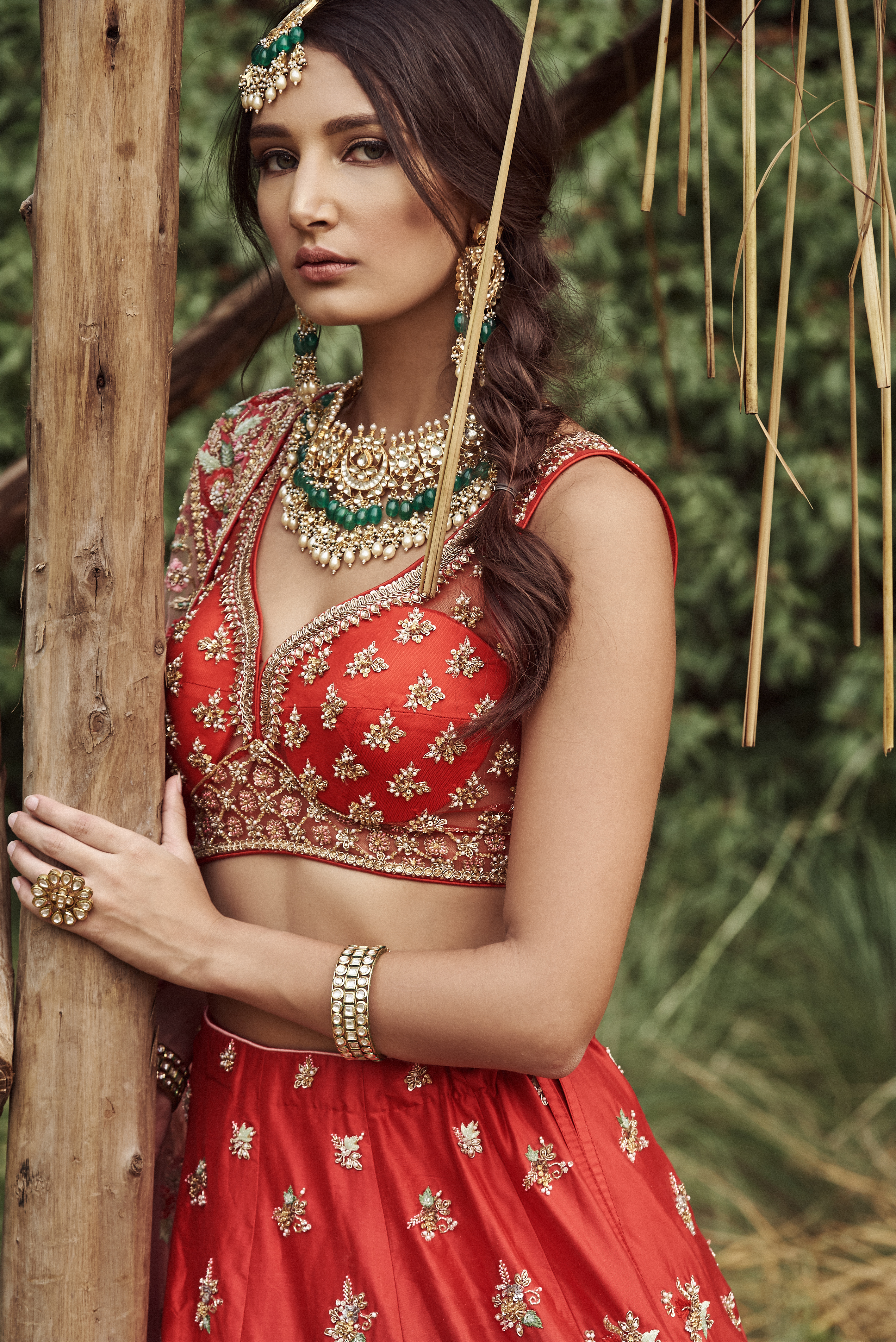 bride in red lehenga and contrasting jewelry