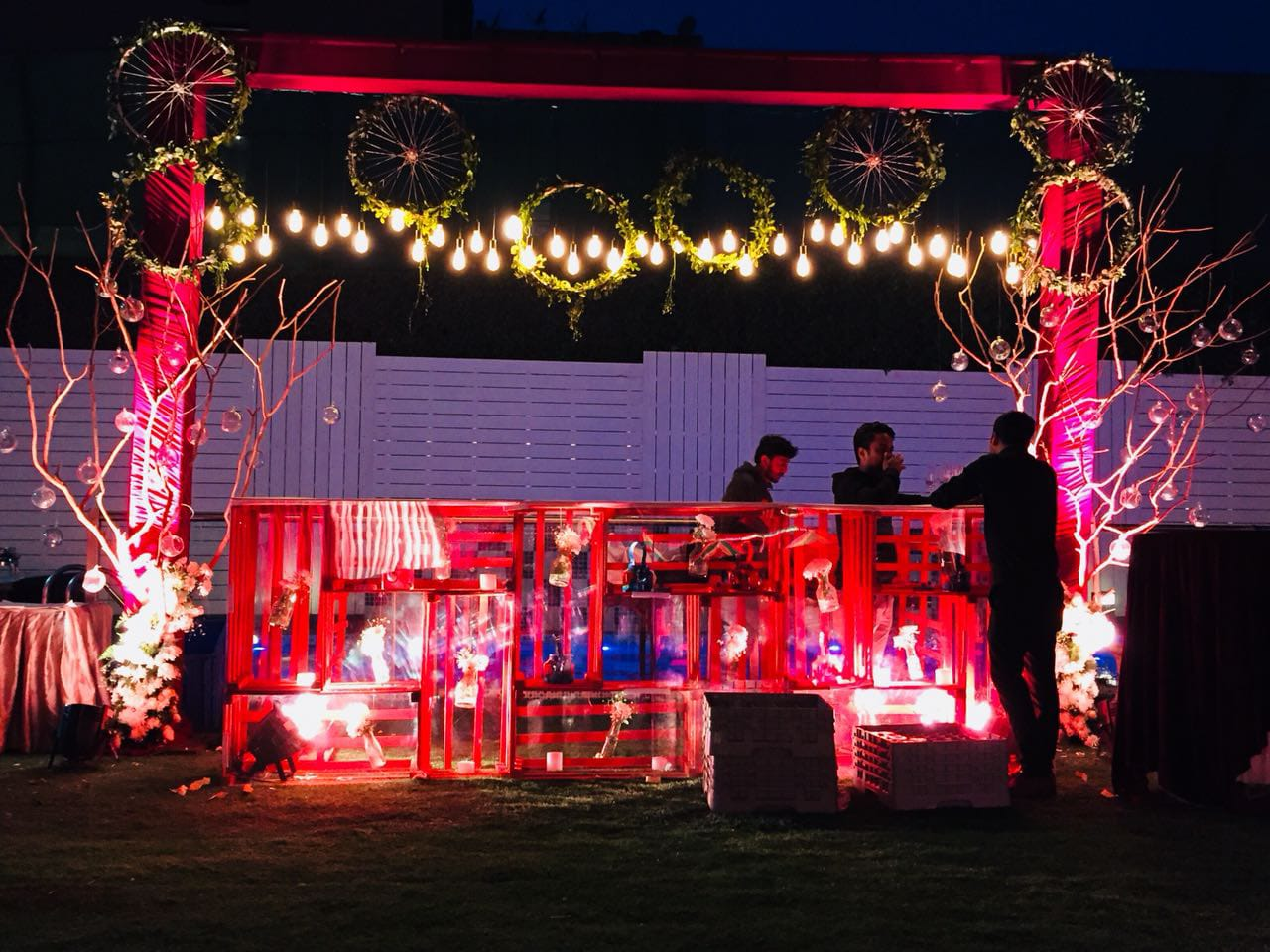 quirky bar in pink shade decorated with lights